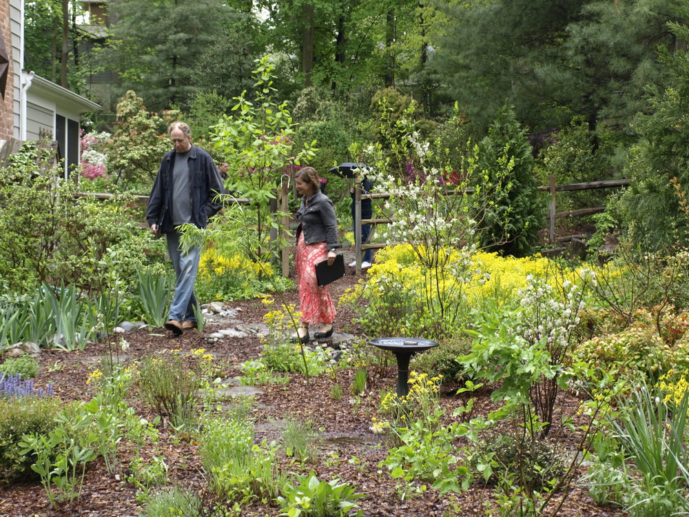 Backyard Bounty, a certified green landscaping company, designed the garden, conservation landscaping and rain garden featured here.