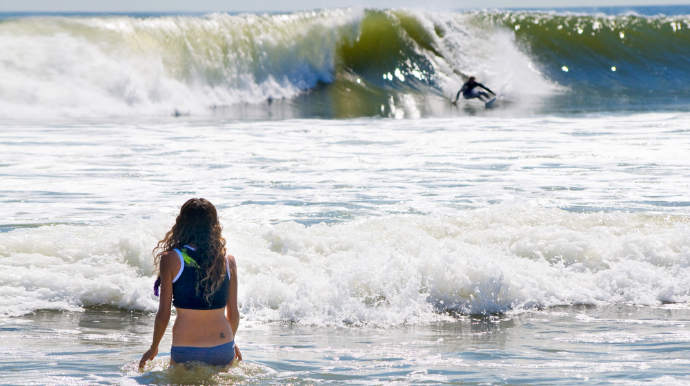 girl watches surfer.jpg