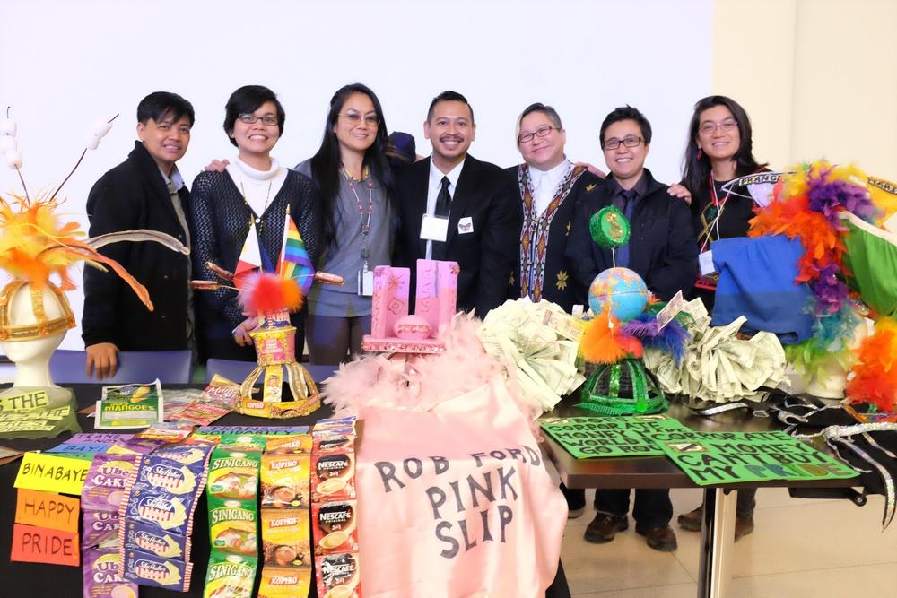 Pj Alafriz, Christine Balmes, Melanya Liwanag Aguila, Robert Diaz, Jo SiMalaya Alcampo,  J Rivera, and Lisa Valencia-Svensson with political Pride costumes.