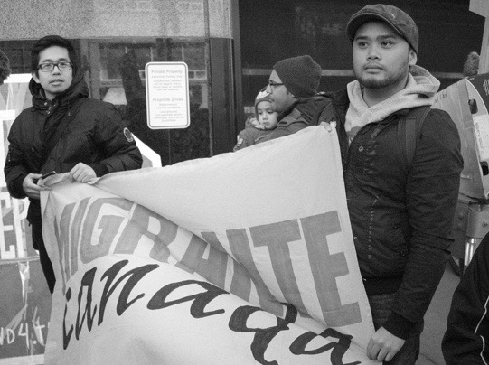 Ysh Cabana and Jesson Reyes at the Cross-Canada Day of Action rally in Toronto, Ontario. Photo by  Edward Hon-Sing Wong.