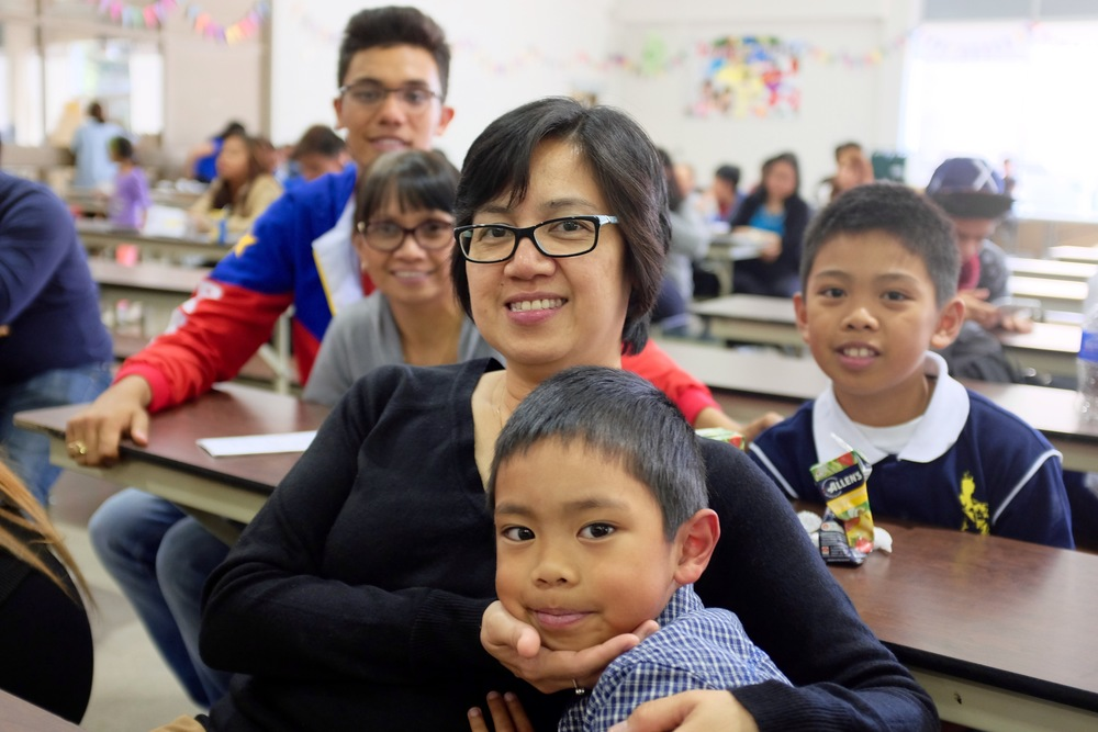 Loida Acol learned about accreditation for her newcomer nephews.