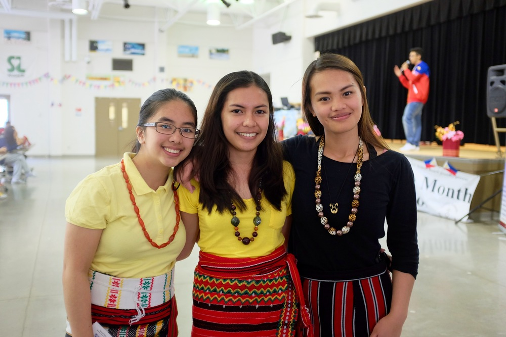 Event volunteers Edithea Faith, Ivy, and Joan Agyod of Northview Heights SS.