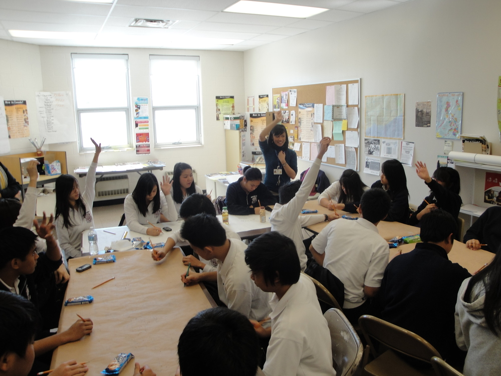 Facilitating an art and settlement workshop with newcomer students at the Toronto Catholic District School Board.