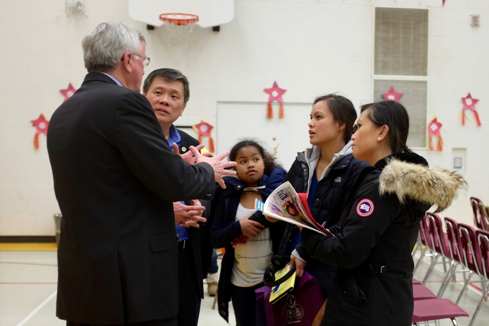 Jerrylyn Gueverra (second from right) advocates for St. Margaret's parents to Trustee Garry Tanuan and Superintendent John Shain. All photos by J. Austria.
