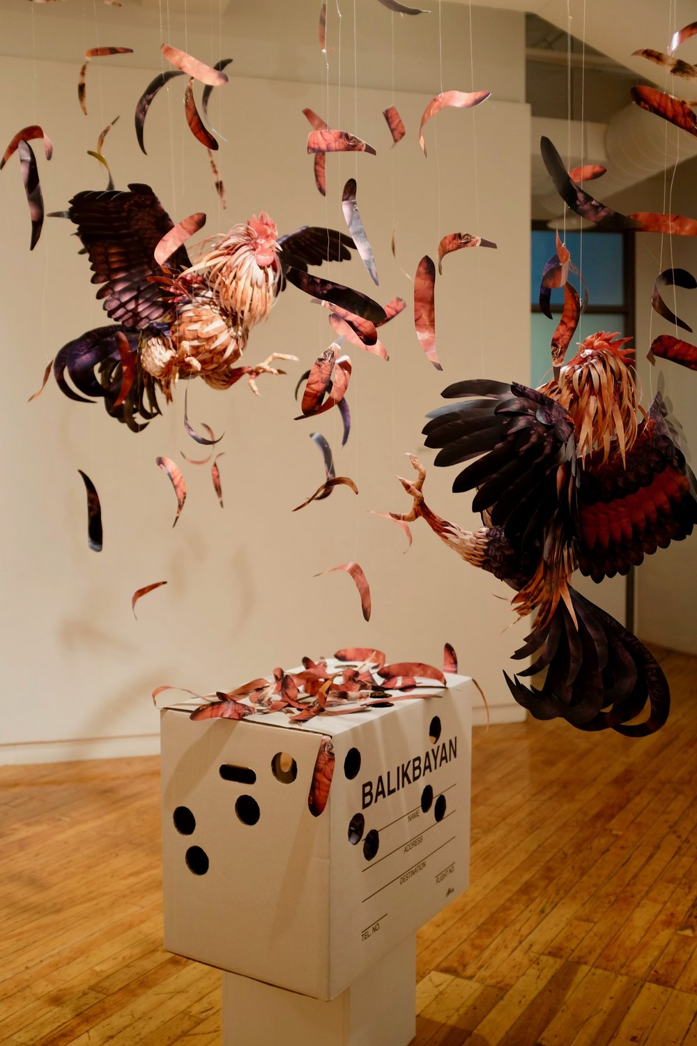 """Julius Poncelet Manapul's piece, """"Whitewash Cockfight"""" in A Space Gallery. Photo by J. Austria"""
