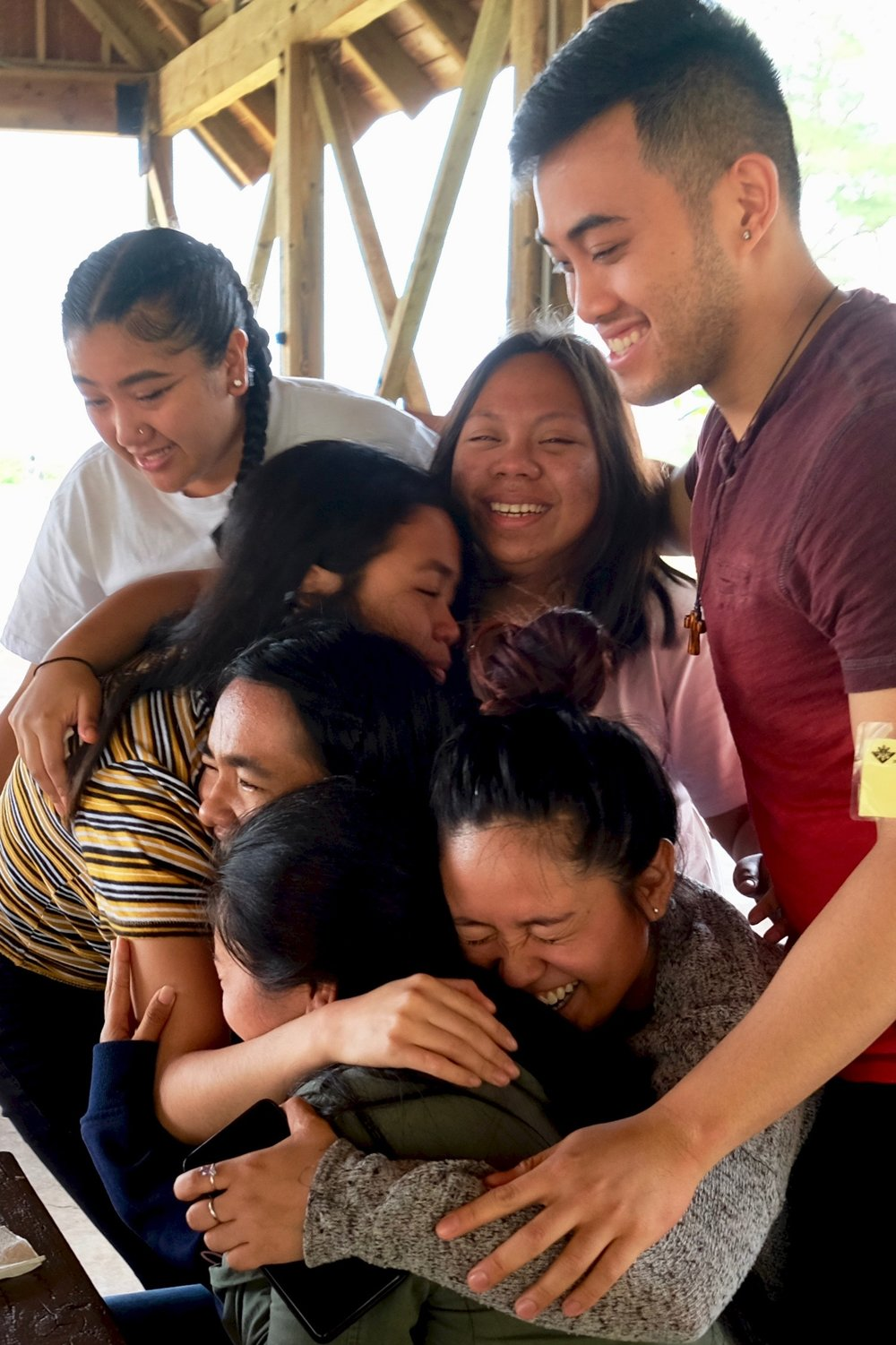 A barangay group hug to cement new bonds being made.Photo by J. Austria.