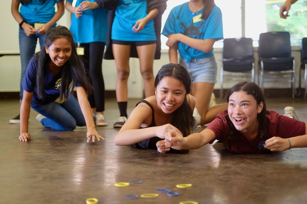 Hilary Naluz of FSAT (middle) playing Lastiko with Abigail Valencia (left) and Nyah Juliano (right).Photo by J. Austria.
