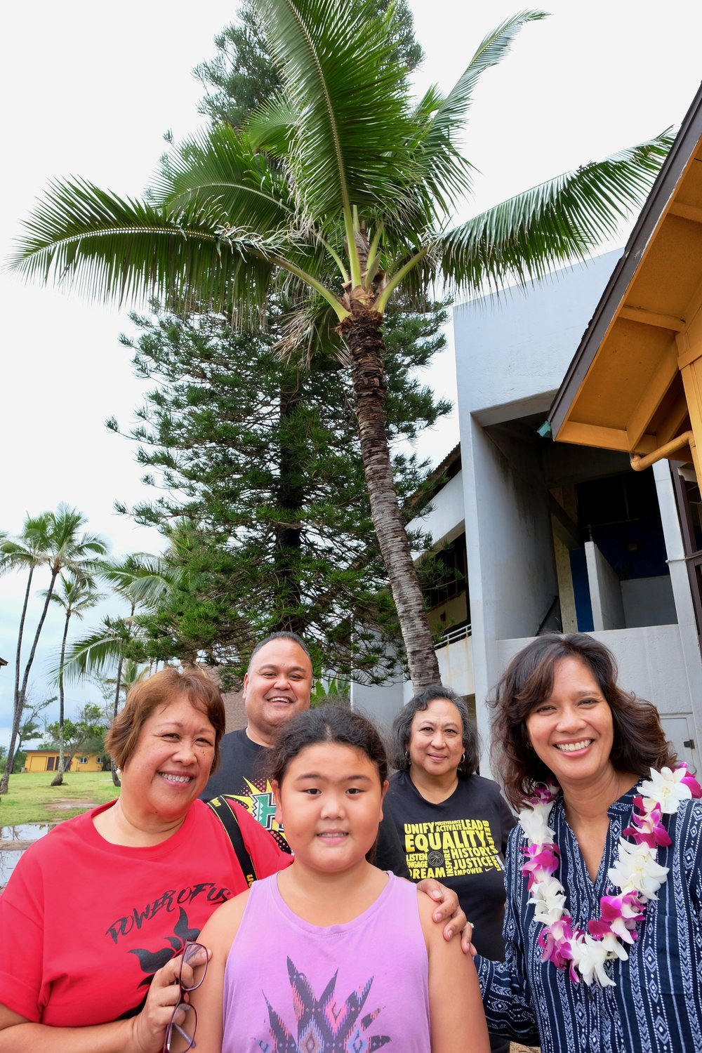 SG President Leon Florendo's daughter Leala, front, with SG Secretary Manang Milli, Leon Florendo, Manang Mia Luluquisen, and Dr. Patricia Espiritu Halagao with the coconut tree planted by SG 38 years ago.Photo by J. Austria.
