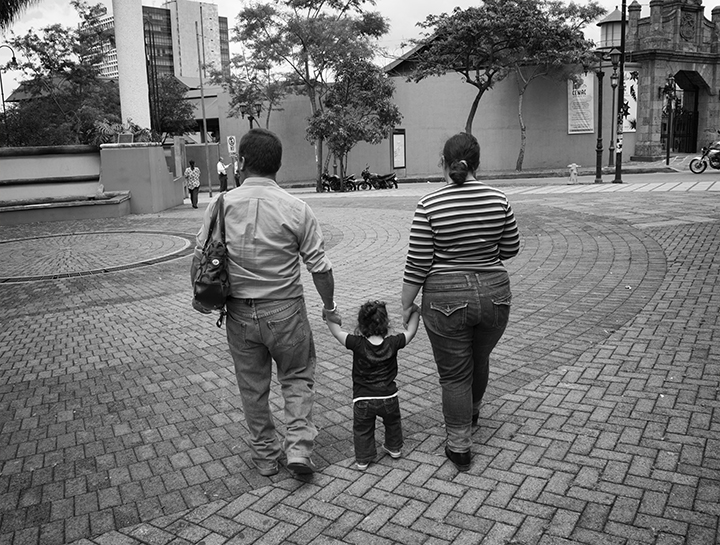 Couple walking with child.jpg