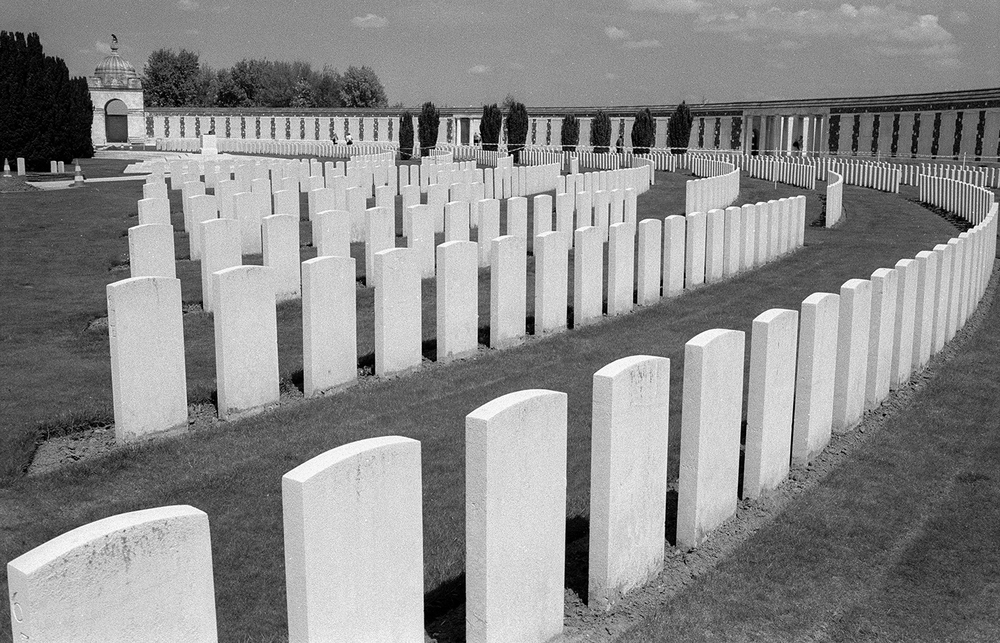 Located near Leper, Belgium, Tyne Cot is largest cemetery for Commonwealth forces in the world, for any war. Among its nearly 12,000 graves are those of two recipients of the Victoria Cross, Britain's highest military honor for valor.