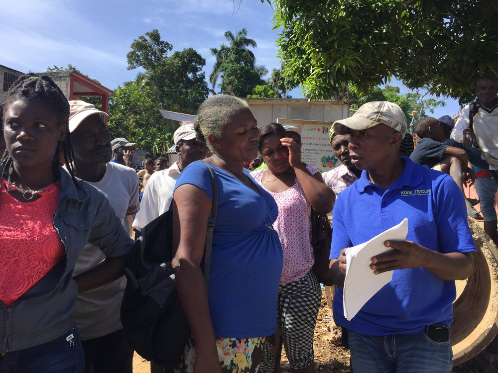 "Families receive instructions for latrine construction from Kore Timoun WASH project manager Metichael ""Meti"" Vilius."
