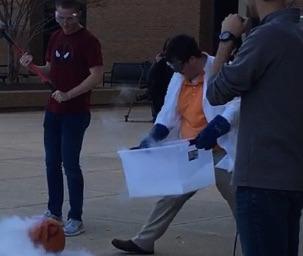 SPS member Seth Kyker prepares to smash a liquid Nitrogen embrittled pumpkin