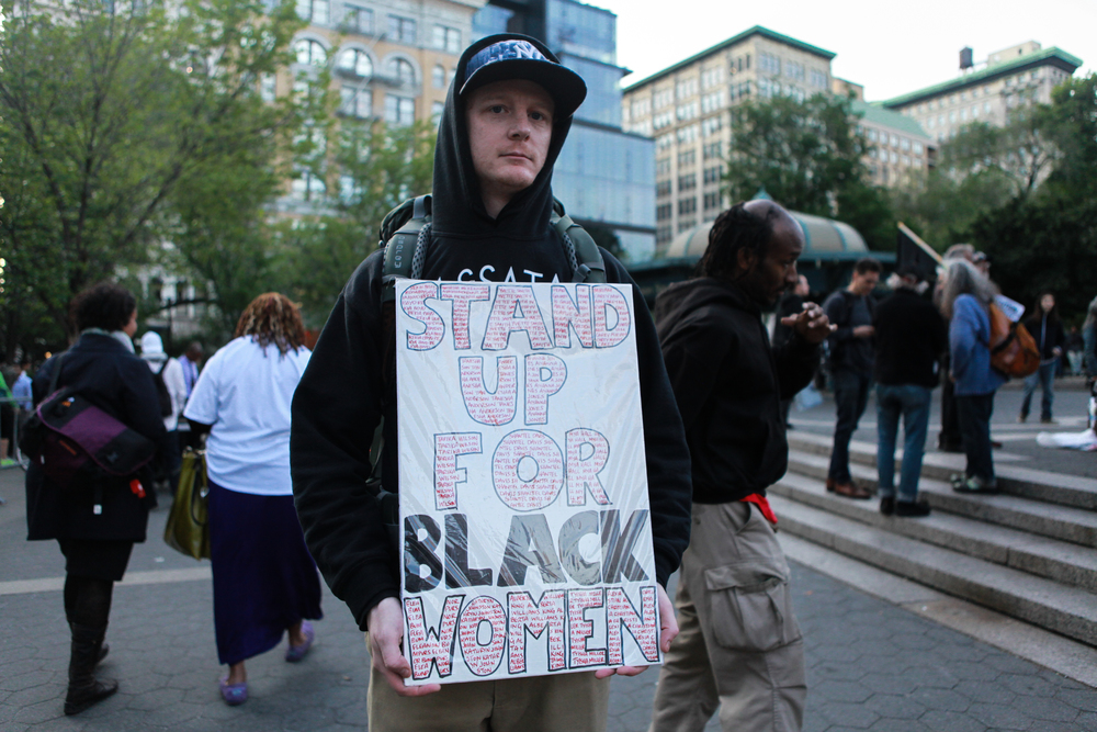 017_Activist Adam Stadacher Holding Sign.JPG