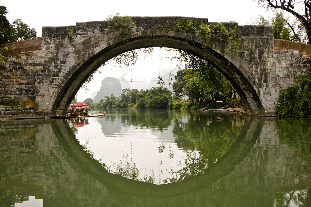 The 600 year old Dragon Bridge on the Yulong River, Yangshuo, Guangxi, China