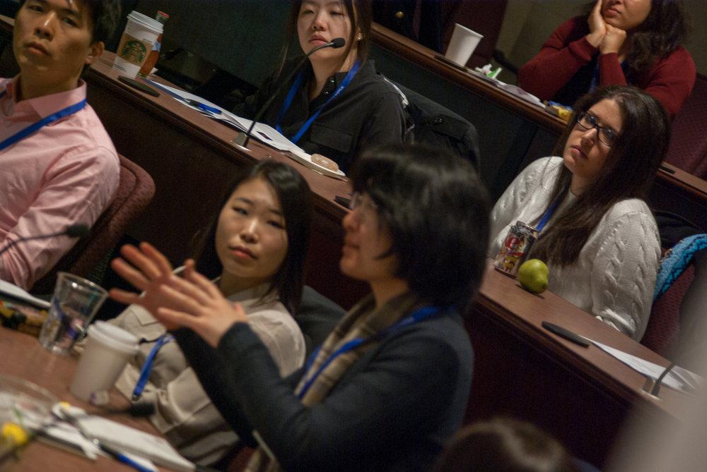 Attendee asking a question following a keynote presentation