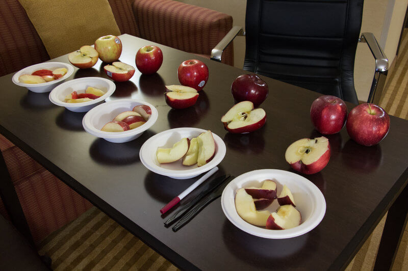 These apples put out for a taste test are (from left): Honeycrisp,  Jazz, Gala, Red Delicious, and Cosmic Crisp. Photo by Dan Charles, NPR
