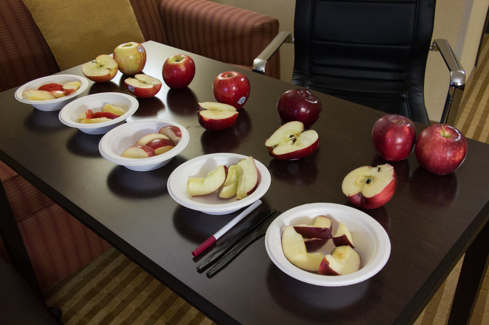 Apples put out for taste tests are (from left): Honeycrisp, Jazz, Gala, Red Delicious, and Cosmic Crisp. Photo by Dan Charles, NPR.