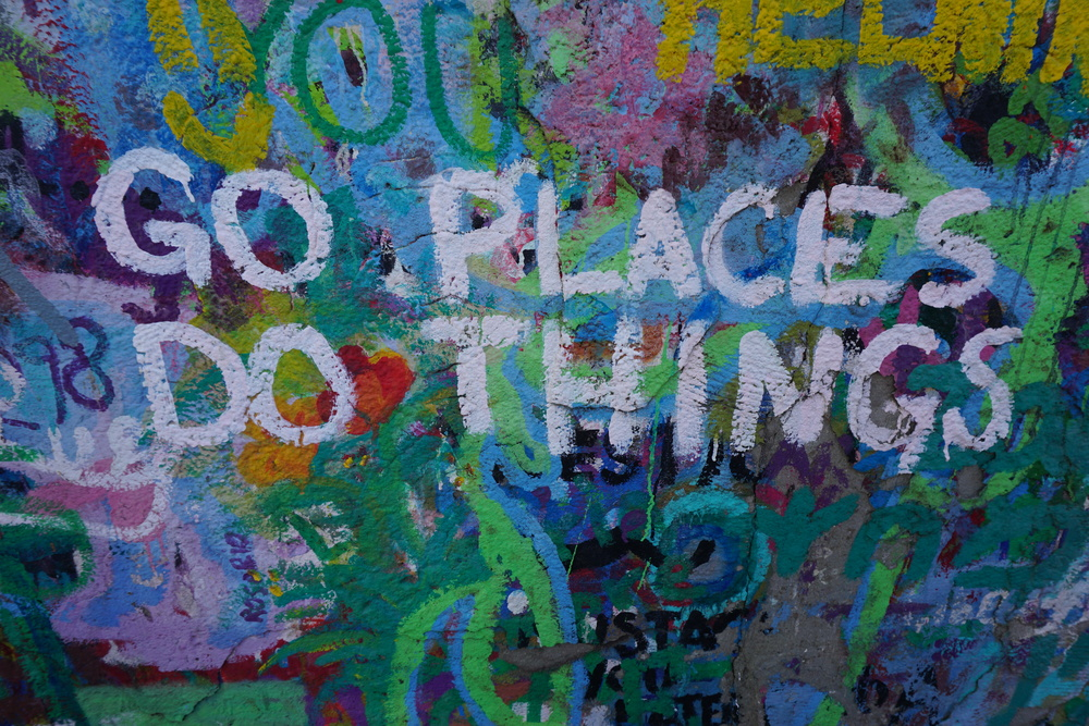 go places do things Tel Aviv graffiti.JPG