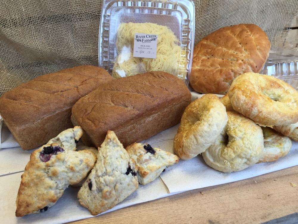 Whole Wheat Loaf, Angel Hair Pasta, Lemon Blueberry Cream Scones, Roasted Garlic Rosemary Boule, Sesame Bagel.