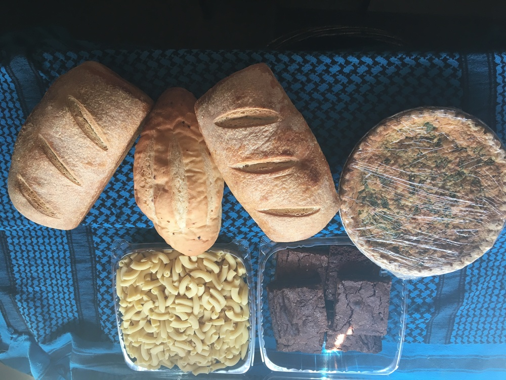 Large bread share~ 2 Sourdough loaves, garlic rosemary batard, penne pasta, Quiche (spinach, feta, bacon), and fudge brownies.