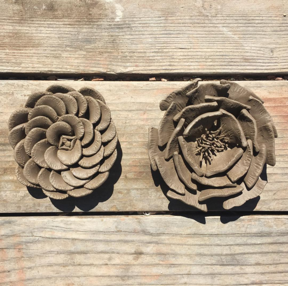 Scored and slipped my scraps away to make these floral sculptures. They were about 5 inches in diameter.