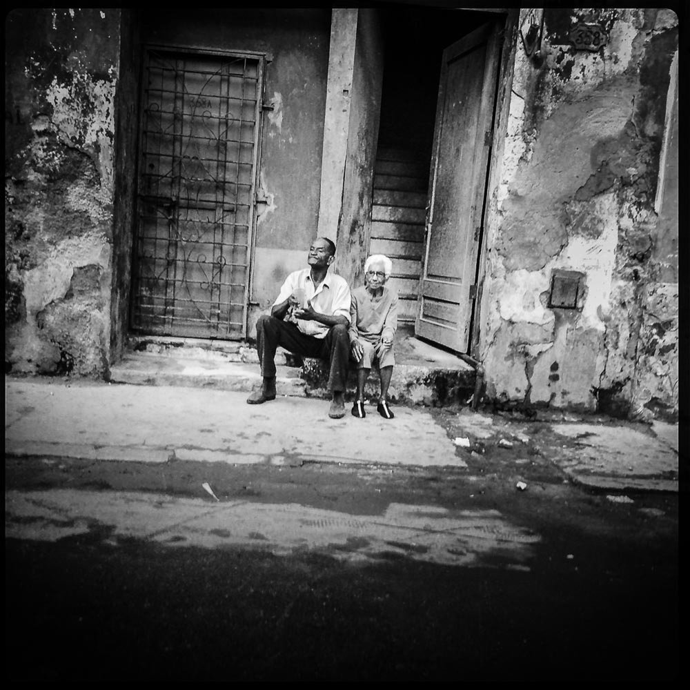 Elderly couple on curb, Havana Cuba 2014