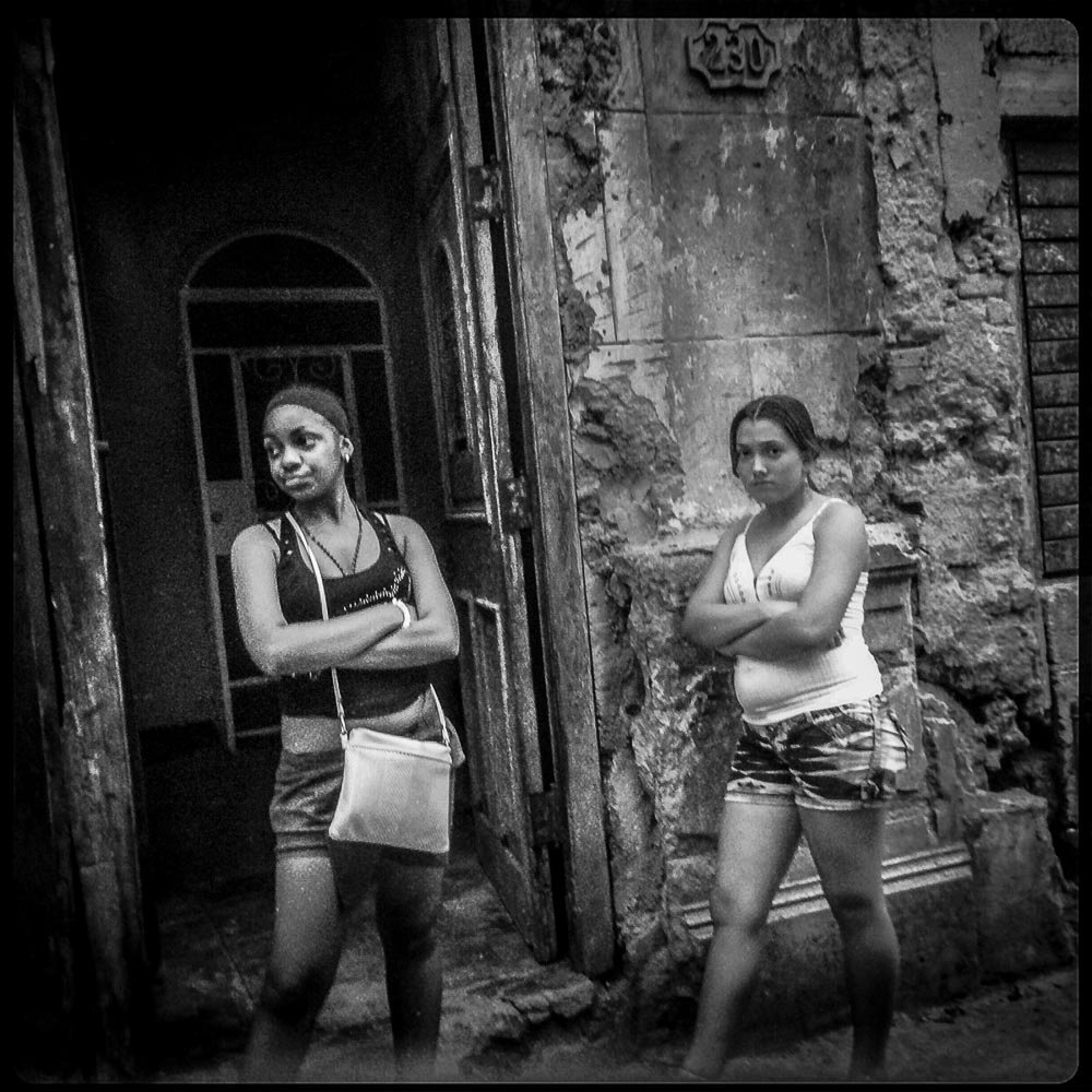 Two girls arms crossed, Havana Cuba 2014