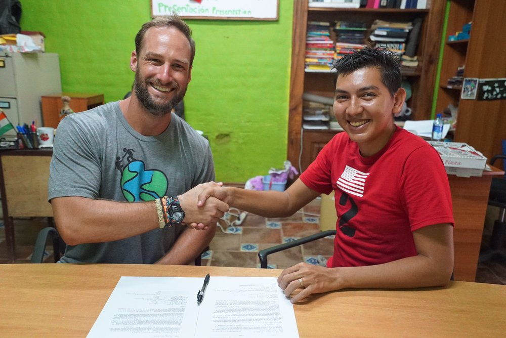 William, our first micro-lending recipient in Nicaragua, signs his interest free loan.  Over the next 12 months, making every payment on time, William expanded a home business selling high end beauty product and is now self-sustainable financially!
