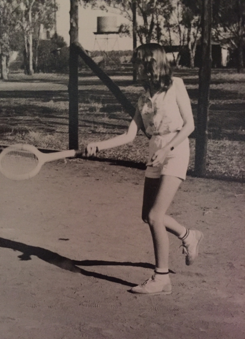 Me at a church tennis outing. I look unenthusiastic, I know, but those old wooden racquets were incredibly small which made ball-contact almost impossible. The sponge cake at afternoon tea, however, was large and delicious and had my total dedication.