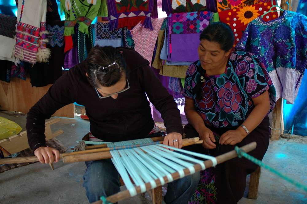 Tanya learning backstrap weaving with Mayan weavers as part of her Artists Helping Artisans initiative.