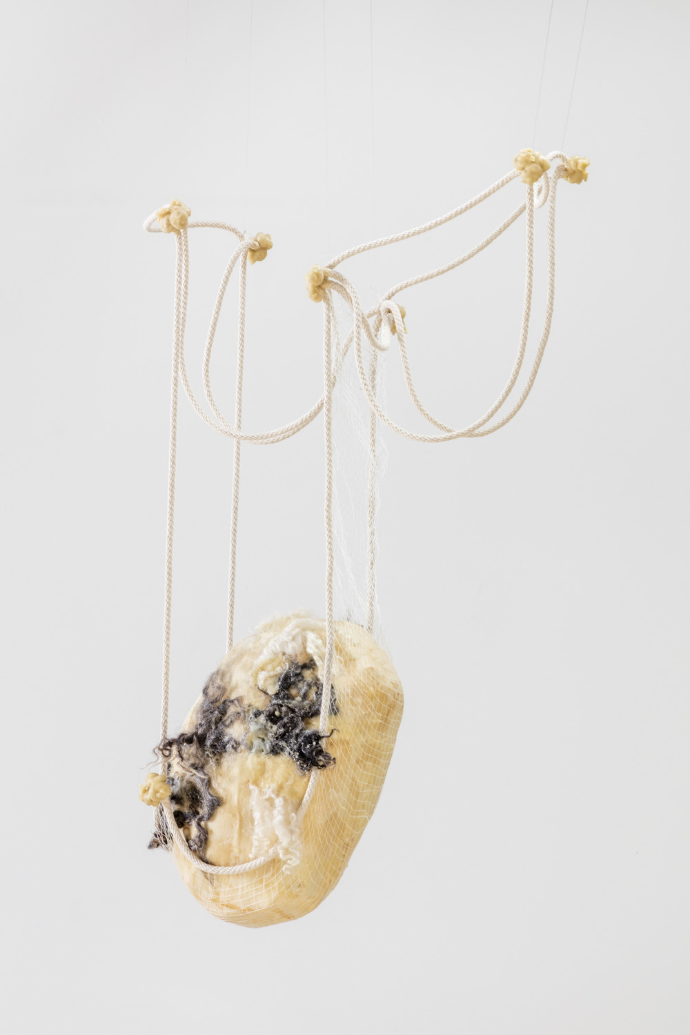 Tanya Aguiniga   Privilege , 2016  Cotton rope, cotton thread, foam, gauze, alpaca, wool and beeswax  33 x 18 x 9.5 inches