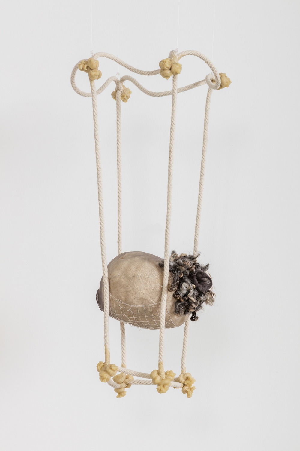 Tanya Aguiniga   Omission , 2016  Cotton rope, cotton thread, foam, gauze, nylon, wool, nylon and beeswax  24 x 10.5 x 8 inches