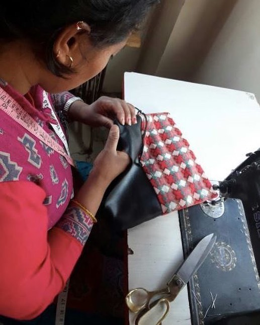 This is is one of our amazing didis, Ambika, handcrafting a one-of-a-kind Dhaka tablet case. After leaving her job at a publishing house in search of more fulfillment, Ambika brought her sewing skills to Haushala Creatives. She has since furthered her skills, gained new knowledge and earned the means to help support her husband and son. Learn more about the didis and shop to support them at haushala.com 🙏✨ #artisan #inspo #womenleader #womenempowerment #haushala #haushalacreatives #etsy #handmade #ethicalfashion #styleblog #socialimpact #nepal #sustainablefashion