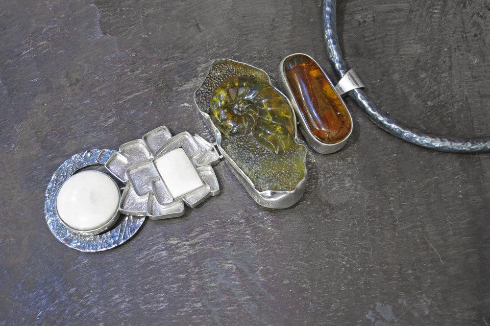 Amber pendant, amber & bone enhancers