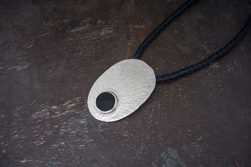 onyx pendant on leather
