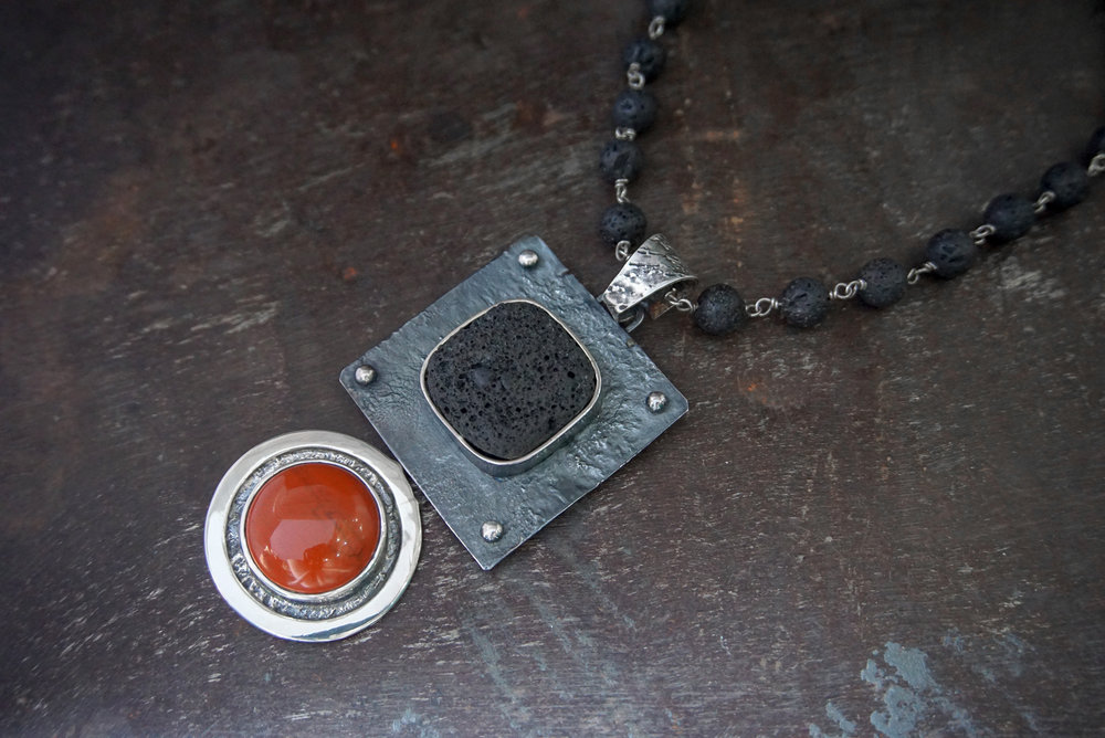lava stone & carnelian enhancers on lava stone necklace