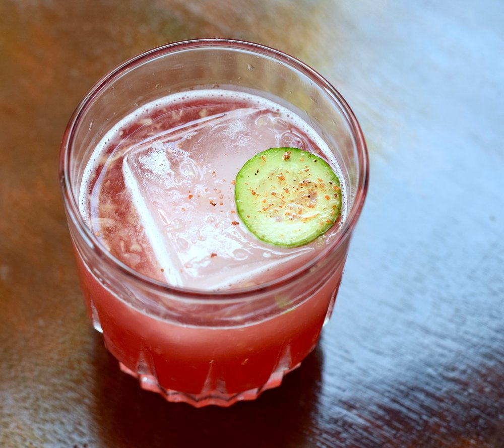 rosarito sun kiss 1 oz nostrum strawberry hibiscus jalapeno shrub 1/2 oz fresh lime juice 4 slices of fresh cucumber 2 dashes peychaud's bitters soda water directions: muddle first 3 ingredients in a cocktail shaker. add ice and shake. top with soda and strain into glass.