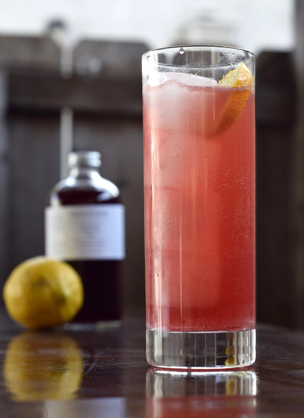 RAINY DAY SCHEDULE - 1 oz nostrum blackberry cacao nib sage shrub1 oz fresh lemon juice1 oz fresh orange juiceginger beerdirections: build in a tall glass filled with ice.