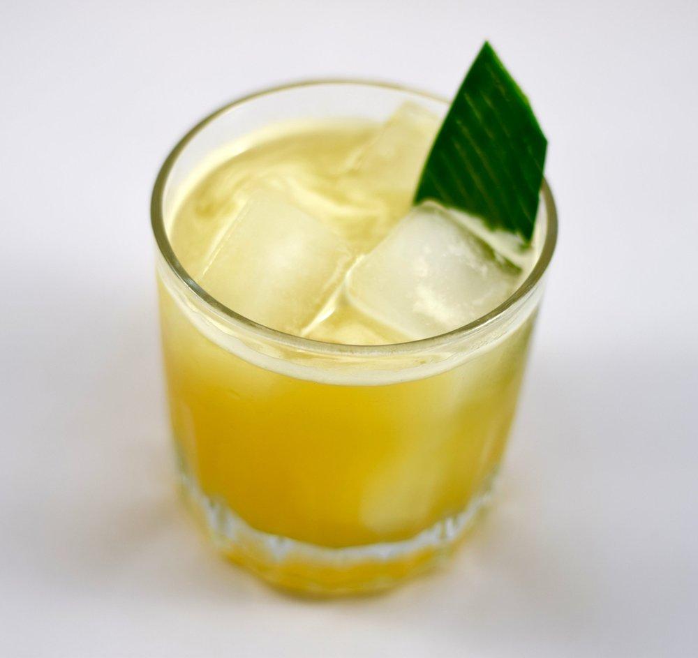BANANA SLING - 1.5 oz white rum1/2 oz giffard banane du brasil liqueur1/2 oz nostrum pineapple turmeric ginger shrub1 oz fresh lime juiceShake with ice and strain.