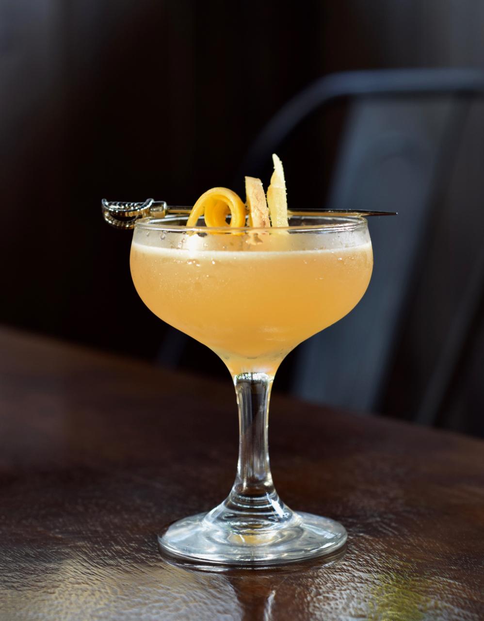 JOHN COMPANY - 2 oz blended scotch1/2 oz nostrum pineapple turmeric ginger shrub3/4 oz fresh lemon juice1/4 oz honey syrup2 dashes angostura bittersShake with ice and strain.