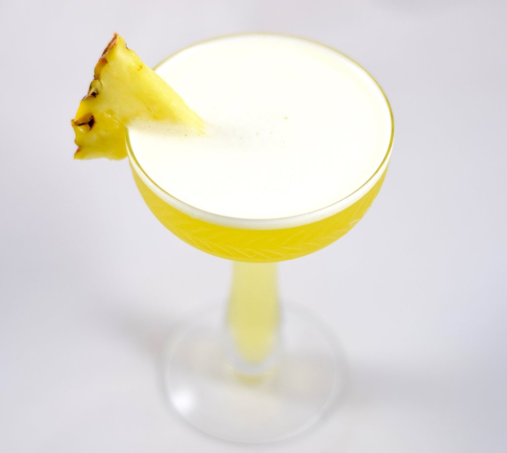 LIBERTAD Y SOLSTICIO - 1.5 oz blanco tequila1/2 oz suze liqueur1/2 oz nostrum pineapple turmeric ginger shrub3/4 oz fresh lime juice2 pineapple slicesMuddle pineapple in a cocktail shaker. Add ice and other ingredients, shake and double strain.