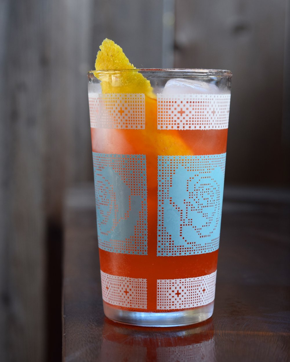 LAYOVER - 1.5 oz gin1/2 oz campari1/2 oz nostrum pineapple turmeric ginger shrub1/2 oz lemon juice2-3 oz soda waterdirections: build in a tall glass with ice.