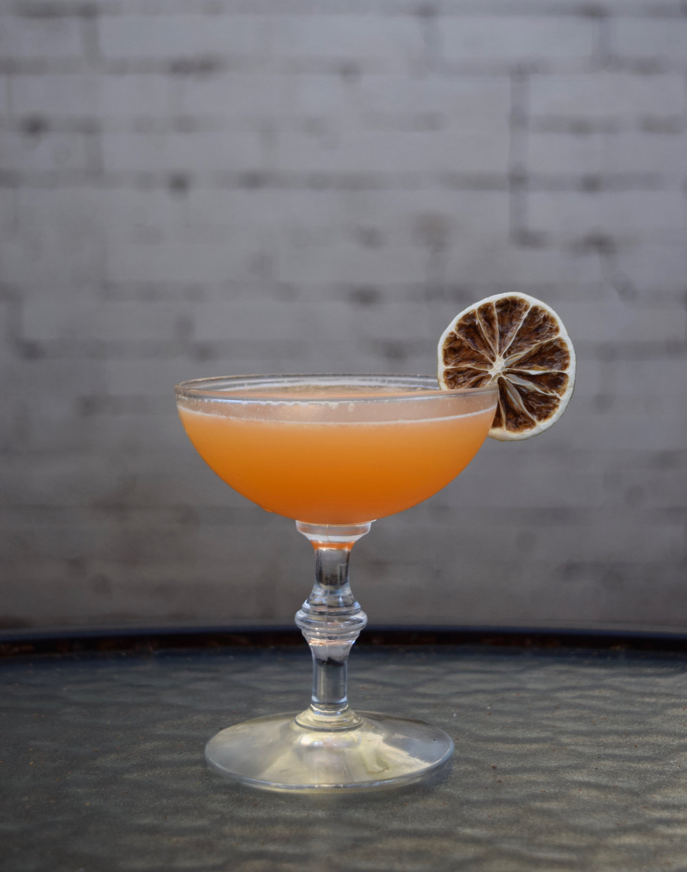 RETROGRADE - 1.5 oz blanco tequila1/2 oz aperol1/2 oz nostrum pineapple turmeric ginger shrub3/4 oz fresh lime juiceShake with ice and strain.