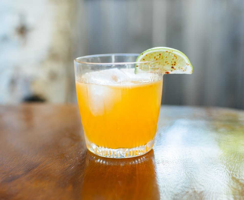 EL CALIFA - 2 oz mezcal1/2 oz nostrum pineapple turmeric ginger shrub3/4 oz fresh lime juice1/4 oz agave nectar10 drops bittermen's mole bittersShake with ice and strain.