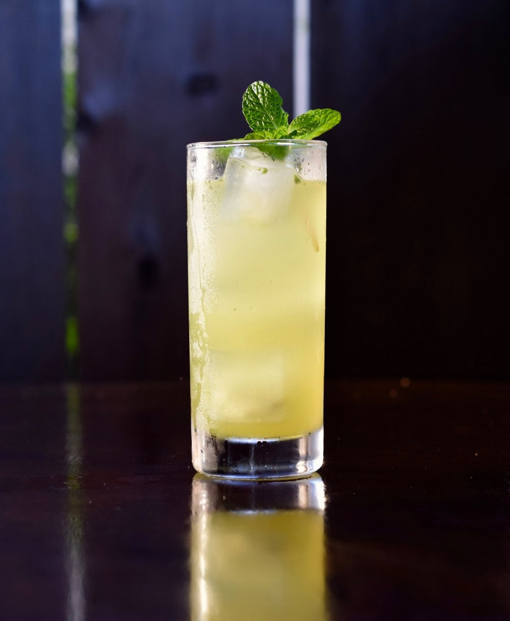 GREEN THUMB - 2 oz cachaça1 barspoon absinthe1/2 oz nostrum pineapple turmeric ginger shrub1/2 oz fresh lime juice1/2 oz simple syrup2 oz soda waterBuild over ice.