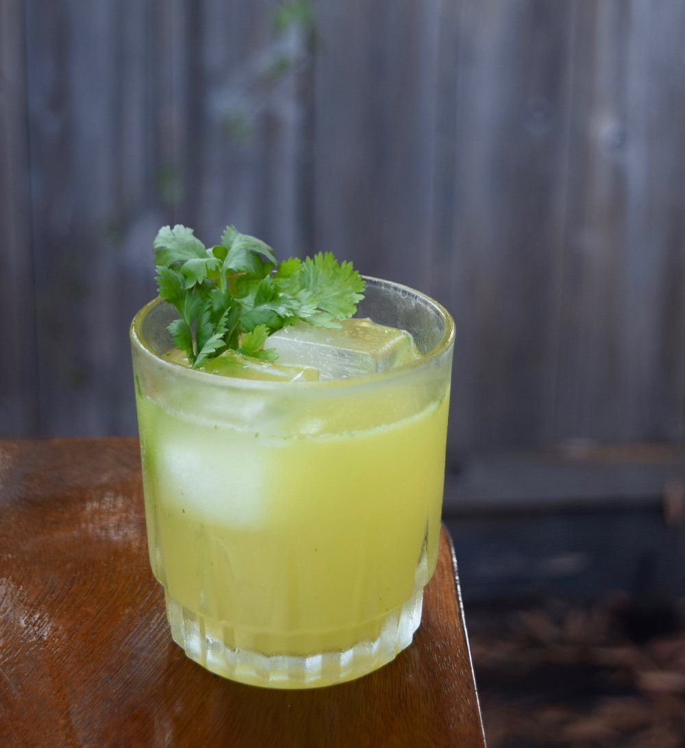 EL JARDINERO - 1.5 oz gin1/2 oz ancho reyes verde liqueur1/2 oz nostrum pineapple turmeric ginger shrub3/4 oz fresh lime juice1/4 oz agave syrup [equal parts agave nectar + water]8-10 cilantro leavesdirections: shake with ice and double strain.