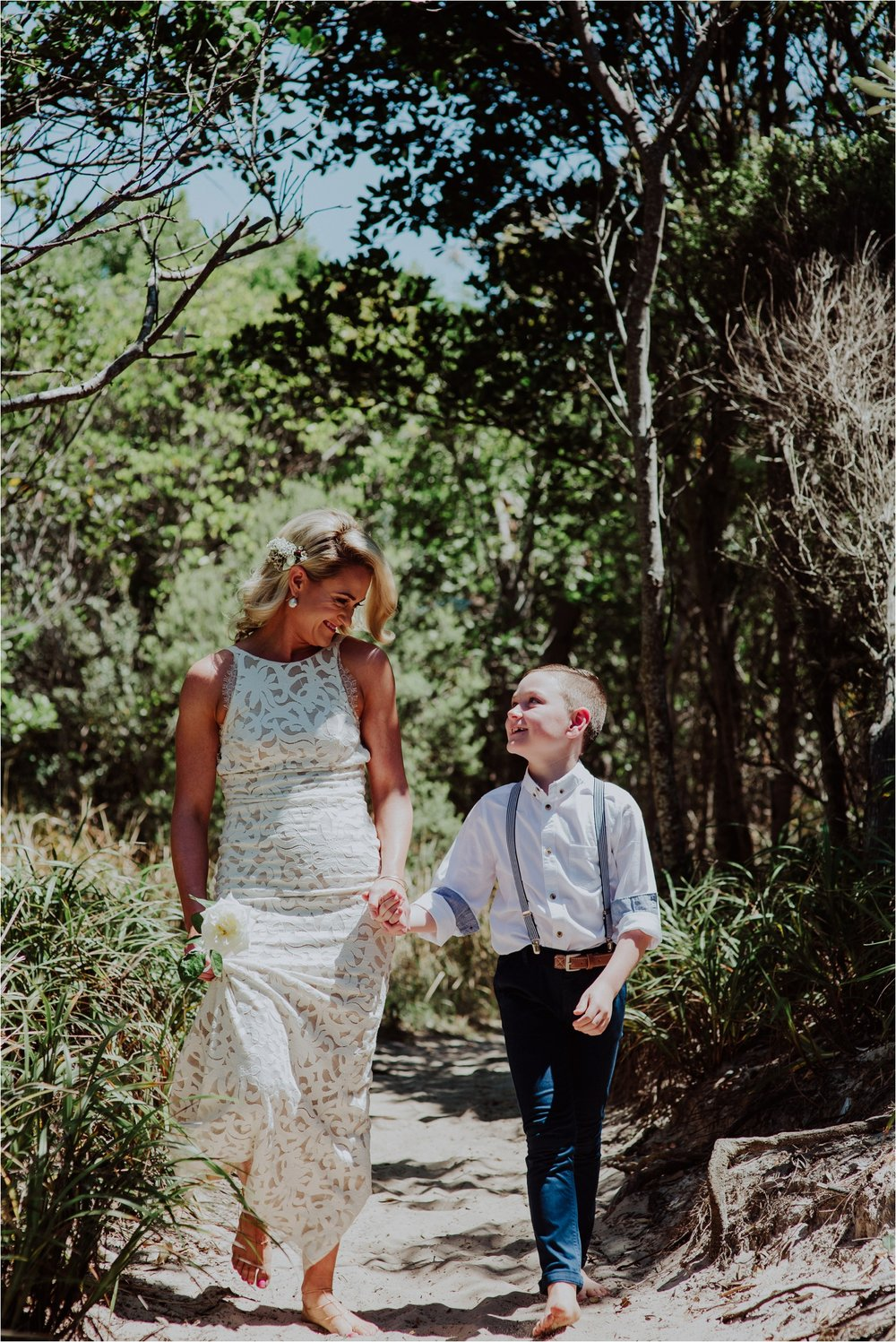 Young son walking bride down aisle at broken head