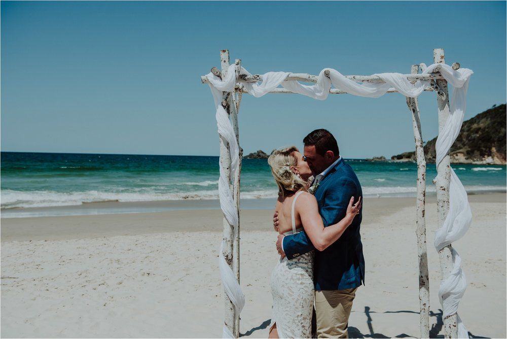 First kiss at byron bay beach wedding