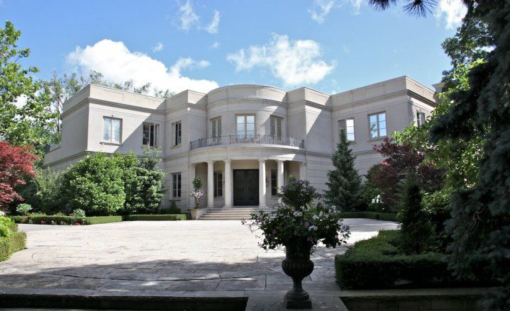 LOCAL RICH AND FAMOUS PERSON IAIN MACNEIL'S MODEST WESTMOUNT HOME.