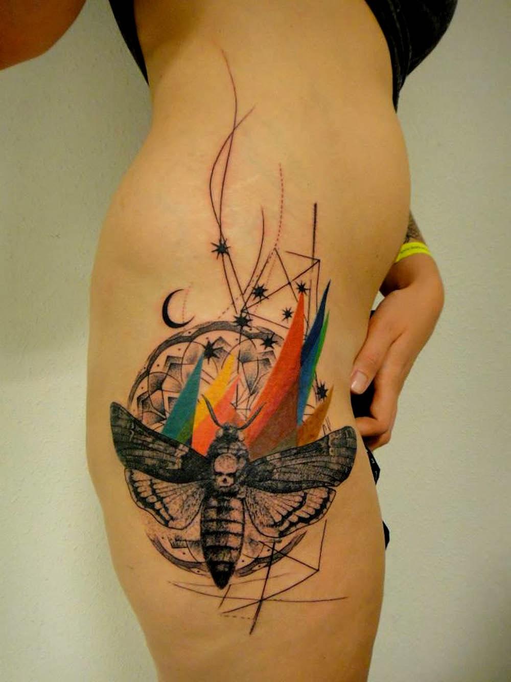 Beautiful-thigh-xoil-tattoo.jpg